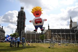 Blimped: Boris Johnson gets the blimp treatment near the Westminster Parliament (Picture: Chris J Ratcliffe/Getty Images)