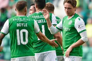 Scott Allan is congratulated by his team-mates after putting Hibs 2-0 ahead. Pic: SNS