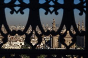 The skyline of Cairo as seen through a window of the Muhammad Ali Mosque in Cairo's Citadel PIC: Ed Giles/Getty Images