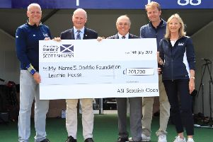 The handover of the cheque for the official charity during the final round of the Aberdeen Standard Investments Scottish Open at The Renaissance Club in July. Pic: SNS