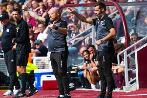 Stuart Kettlewell (right) was proud of Ross County's players in the 0-0 draw at Tynecastle.