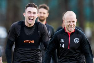 John Souttar and Steven Naismith share a joke in training