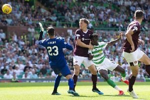 A combination of Hearts defender Christophe Berra and Celtic striker Vikoun Bayo combine to open the scoring for the hosts. Pic: SNS