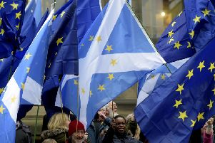 Scottish flags are prominient in this rally in Edinburgh calling for a People's Vote on Brexit. Picture: Lisa Ferguson