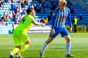 Stevie Mallan and Kilmarnock's Rory McKenzie clash during the last meeting between the sides at Rugby Park.