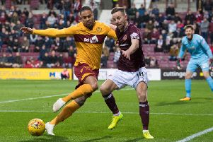 Motherwell's Charles Dunne and Steven MacLean battle for possession.