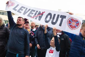 Hearts fans make their feelings known. Picture: SNS