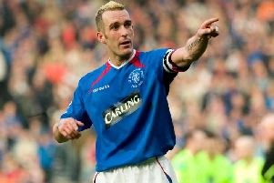 Fernando Ricksen in action for Rangers