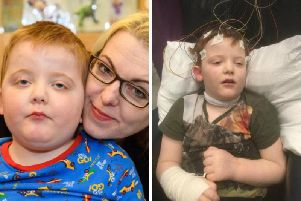 Karen Gray and son, Murray, shown in one picture in what his mum calls 'out of status.'