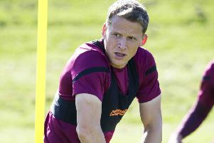 Christophe Berra feels one win can spark Hearts' season. Pic: SNS