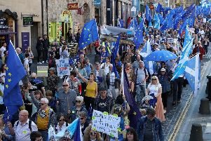 Demonstrators gathered on the Royal Mile before proceeding to a rally held outside the Scottish Parliament at Holyrood.