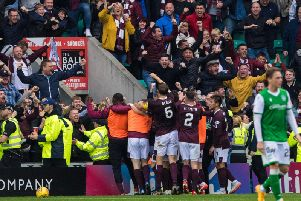 Hearts fans celebrate at Easter Road. Picture: SNS