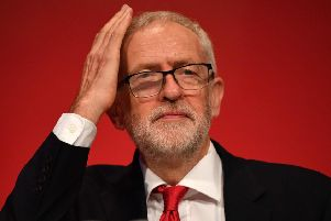 Labour Party leader Jeremy Corbyn gestures on stage at the Labour party conference in Brighton. Picture: Getty Images