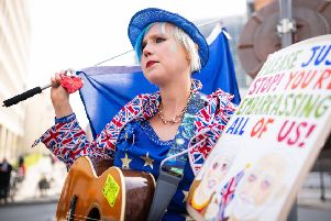 Madeleina Kay ' the EU Super-Girl ' attended Saturday's march against Brexit in Edinburgh. Picture: Getty