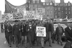 Workers from the Henry Robb shipyard in Leith march to demonstrate against job redundancies in April 1983.
