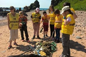 The pupils with some of the litter that they collected on the beach