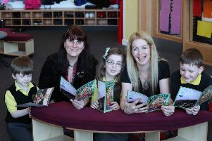 Catriona Zappert, right, at the school which was first to get copies of the book.