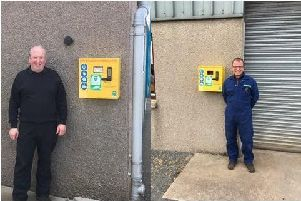 Gordon Kelly of the Overton Garage and Stuart Duncan of Michaelmuir Garage with the new defibrillators