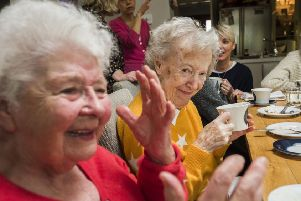 Cheers! Contact the Elderly guests enjoying an afternoon tea party
