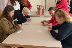 Pupils learn how to make the Poppy Scotland charity poppy inside the Bud vehicle
