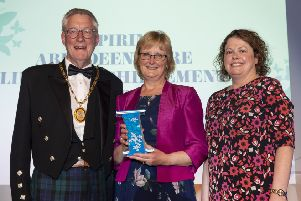 Alison Young accepted her award fro the Provost of Aberdeenshire Councillor Bill Howatson