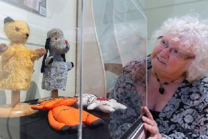 Councillor Anne Simpson with the original Sooty and Sweep puppets at the new exhibition.