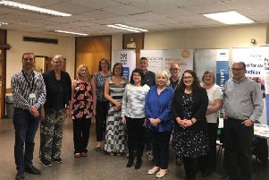 Danielle Rowley MP (front right in black) co-hosting a mental health wellbeing session and joint surgery in Penicuik.