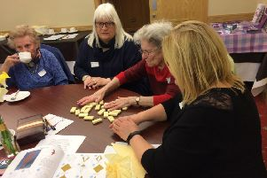 Fun and games...are enjoyed by people living with dementia and their carers at a number of monthly cafes, held across the Borders thanks to the dedicated volunteers who run them.