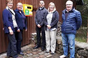 Pictured (left to right) with the PAD are Ann Baillie (Trustee), Jan Lythgoe, Malcolm White of Aberdeenshire Council, Pat Sturrock (chair of the Bennachie Centre Trust) and Jon Nicol (Trustee).