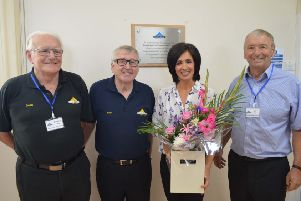 Andrea Brymer with, left to right,  Douglas Knox, secretary, Andy Lorimer, vice-chairman, and Bill Allan, chairman