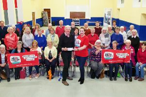 The Ythan Singers hand over a cheque for �1500 to Gillian Webster of The Brain Tumour Charity