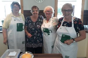 Mary Watson and her girls celebrate her last Macmillan World's Biggest Coffee morning.