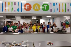 Ellon Primary School pupils with the cooking team and their special guests at the kitchen opening event