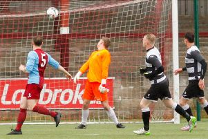 Andy Rogers chips home Shire's second in Saturday's win over Whitehill Welfare in their final home league game at Ochilview.