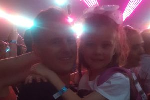 Dad Scott took Jessica Laing (7) along to her first concert.