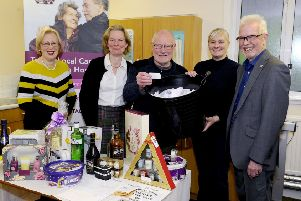 Patron Dennis Canavan conducting The Driving Force's Grand Christmas Prize Draw alongside (L to R) fundraiser Charlotte Campbell, founder Dr Bridget McCalister, fundraiser Karen Coyle and chairman David McMillan. Picture: Michael Gillen