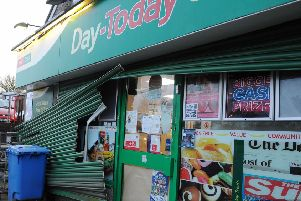 Shutters were damaged during the break-in at Maddiston Post Office. Picture: Michael Gillen