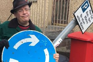Cllr Johnny Tepping with the damaged sign in Newport