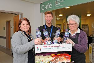 Appeal...Lorna Stevenson (left) hopes more people will join the  ranks. She is pictured with service assistant Shane McCann and volunteer Lesley Leishman. (PIc: Michael Gillen)