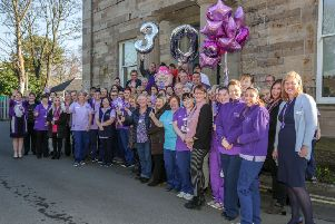 Employed and voluntary staff at the Ayrshire Hospice gather outside to celebrate the 30th anniversary