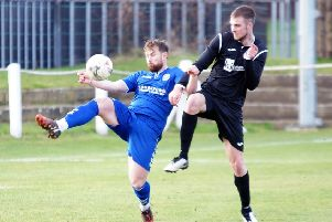 Dundonald (in blue) in action against Dalkeith