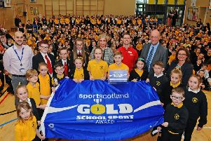 Maddiston Primary pupils and teaching staff are presented with their award by sportscotland chief executive Stewart Harris. Picture: Michael Gillen