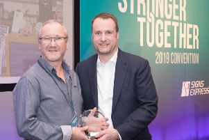 Signs Express (Falkirk) owner Steve McMurray, left, receives his award from group managing director Jonathan Bean.