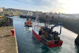 Eyemouth lifeboat tows a trawler into the harbour after it suffered engine failure.