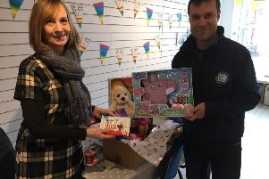 Pictured is Chrisetta Mitchell of The Leanne Fund with Paul Condy of The Scottish Salmon Company with a Pamper Hamper.