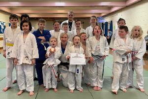 Jayne Clason celebrates winning British Judo Council coach of the year with her young pupils at Deanburn Judo Club in Grangemouth