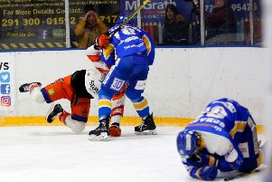 Fife Flyers: Chase Schaber lies injured on the ice after a hit in the game versus Sheffield Steelers (Pic: Steve Gunn)