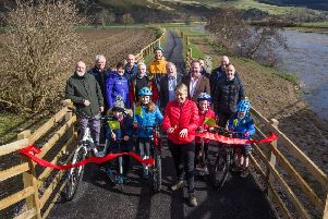 Council leader Shona Haslam, alongside several interested parties, officially opened the path between Innerleithen and Walkerburn.