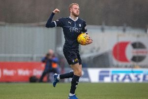 Zak Rudden runs back to the half way line after equalising.