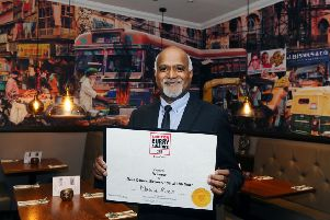 Masala Ram's owner Ram Salhotra proudly shows off the award
